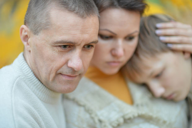 bigstock-Sad-family-of-three-on-the-nat-55857230
