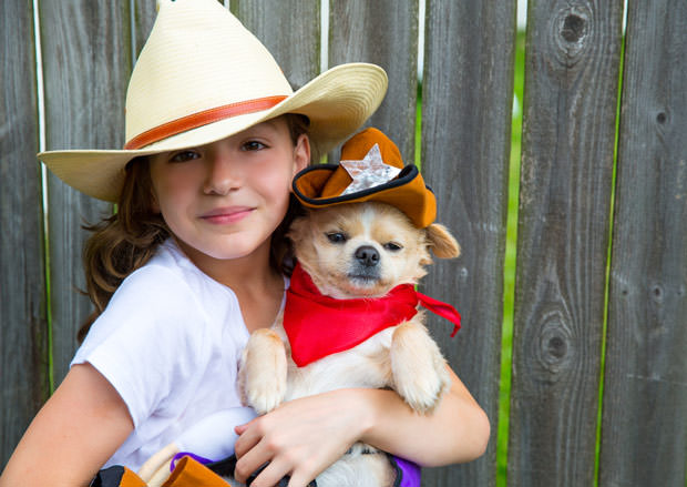 bigstock-Beautiful-cowboy-kid-girl-hold-51746902