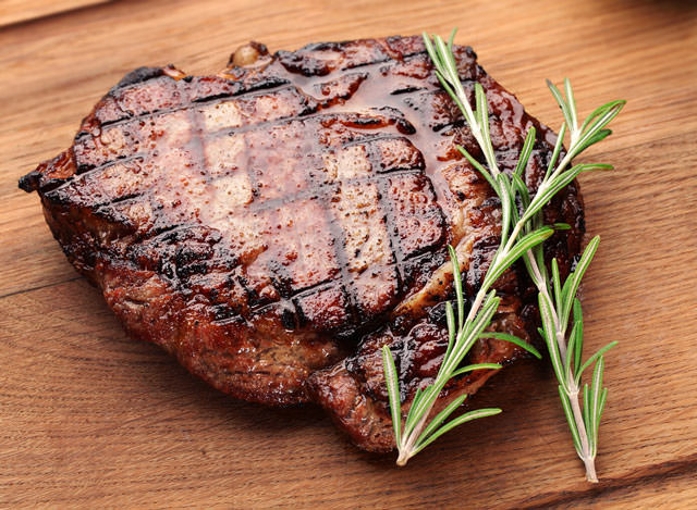 bigstock-Beef-steak-on-a-wooden-table--38829283