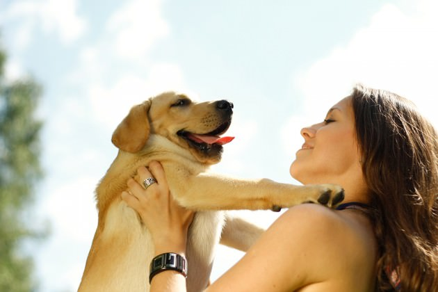 bigstock-Girl-with-her-dog-resting-outd-18223091