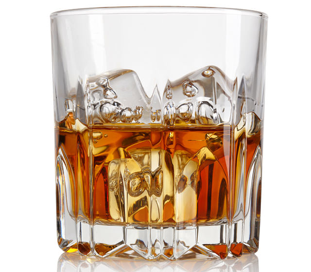 bigstock-Glass-of-whiskey-and-ice-isola-36482110