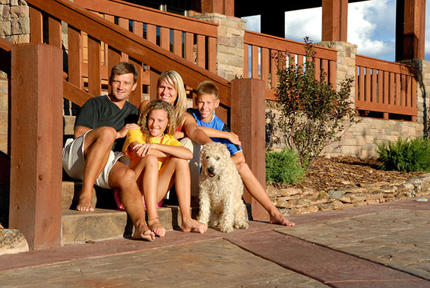 bigstock-Happy-family-on-front-steps-15064244