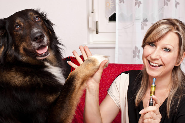 bigstock-Young-Woman-With-Dog-And-E-cig-36632278